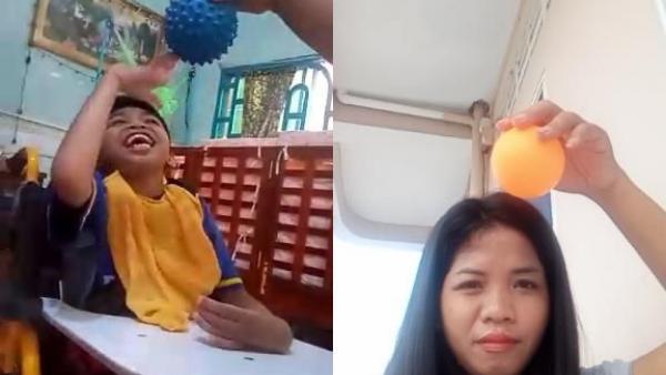 Un enfant porteur de handicap fait des exercices de motricité depuis chez lui avec l'aide de son éducatrice en visio